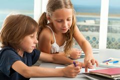 Free Girl Helping Boy With Homework. Royalty Free Stock Photography - 27338197