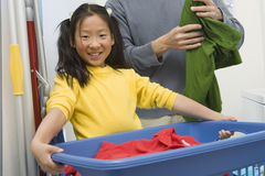 Girl Helping Father At Household Work Royalty Free Stock Image