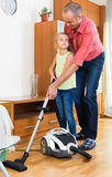 Girl helping father to do clean-up Royalty Free Stock Images