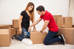 Girl helping her boyfriend move Stock Photos