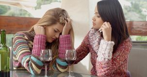 Girl Helping her Depressed Friend at the Cafe. Kind Girl Helping her Friend Suffering from Depression While Drinking Wine at the Cafe stock video