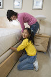 Girl Helping Her Mother For Household Work Stock Photography