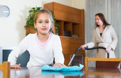 Girl helping mom to do cleaning Royalty Free Stock Photo