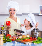 Girl helping mother to prepare Stock Photo