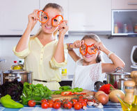 Girl helping mother to prepare Royalty Free Stock Image