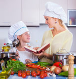 Girl helping mother to prepare Royalty Free Stock Photo