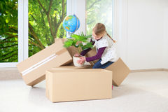 Girl helping moving house royalty free stock image