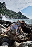Girl helps another girl after shipwreck Royalty Free Stock Photography