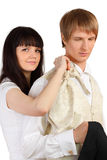Girl helps man to dress holiday suit Royalty Free Stock Photos