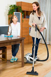 Girl helps mother to clean room Royalty Free Stock Images