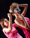 Girl helps other girl. The girl helps other girl with a mask Stock Images