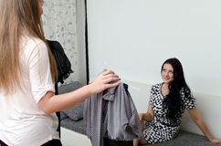 Girl helps to choose dress Stock Images