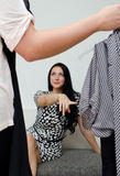 Girl helps to choose dress Royalty Free Stock Image