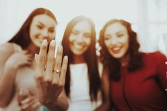 The Girl On Hen-party Shows An Engagement Ring. Close-up. Pre-wedding Care Concept. Beautiful Shiny Smile. Resting With Bride. Sunny Day. Good Mood. Young And royalty free stock photo