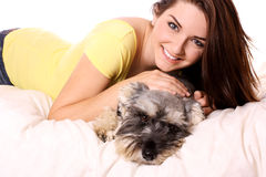 Girl with her adorable Schnauzer Stock Photography