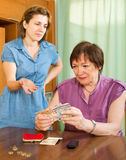 Girl and her aged mother having financial problems Royalty Free Stock Image
