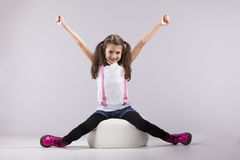 Girl with her arms outstretched Stock Images