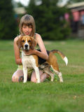 Girl with her beagle. Royalty Free Stock Photo