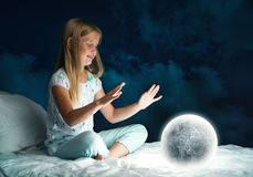 Girl in her bed and moon planet Royalty Free Stock Images