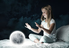 Girl in her bed and moon planet Royalty Free Stock Photos