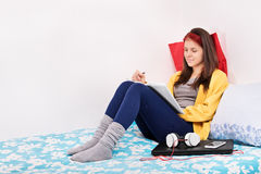 Girl in her bed writing something Royalty Free Stock Images