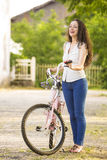 Girl with her bicycle Royalty Free Stock Photography