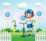 A girl and her bicycle Stock Images