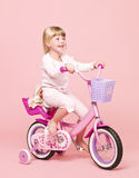 Girl on her bike Royalty Free Stock Photography
