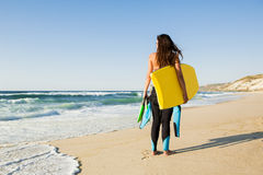 Girl with her bodyboard Royalty Free Stock Images