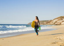 Girl with her bodyboard Stock Image