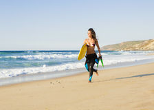 Girl with her bodyboard Royalty Free Stock Image