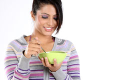 Girl with her bowl of breakfast Royalty Free Stock Image