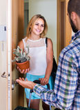 Girl and her boyfriend with luggage moving together Royalty Free Stock Image