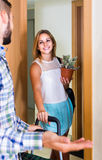 Girl and her boyfriend with luggage moving together Stock Photos