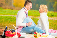 Girl and her boyfriend at a picnic Royalty Free Stock Image