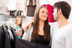 Girl And Her Boyfriend Are Shopping For Clothes Royalty Free Stock Photo