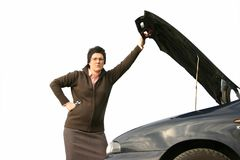 Girl with her broken car 3 Stock Photos