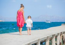 Girl with her brother walking Stock Photos