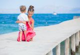 Girl with her brother walking Royalty Free Stock Photography