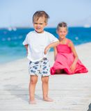 Girl with her brother walking Royalty Free Stock Photo