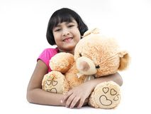 Girl with her brown teddy bear Royalty Free Stock Photo
