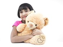 Girl with her brown teddy bear Stock Images