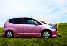 Girl with her car Royalty Free Stock Images