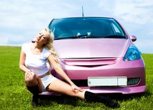 Girl with her car Royalty Free Stock Image