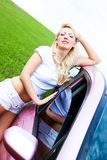 Girl with her car Royalty Free Stock Photography