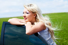 Girl with her car Royalty Free Stock Photos
