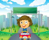 A girl in her car below an empty signage Royalty Free Stock Images