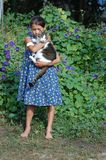 Girl with her cat Stock Photo