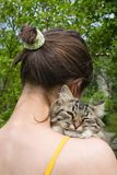 Girl And Her Cat. Girl teenager holding and hugging her cat Stock Photo