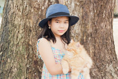 Girl with her cat Stock Images